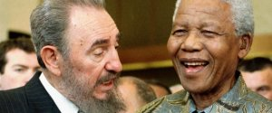 Cuban leader Fidel Castro, left, shares a laugh with South Africa President Nelson Mandela at the World Trade Organization held in Geneva Tuesday, May 19, 1998. Mandela and Castro said in separate speeches that the global trading system had failed to achieve its goals of bringing a higher standard of living to many developing countries. (AP Photo/PATRICK AVIOLAT) | ASSOCIATED PRESS