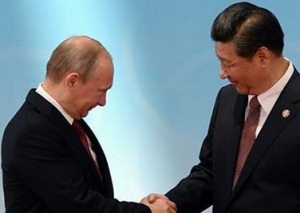 Russia's President Vladimir Putin shakes hands with his China's counterpart Xi Jinping (RIA Novosti/Mikhail Klimentiev)