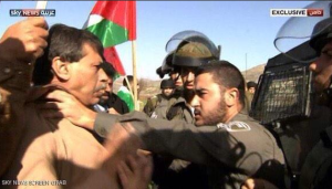 Photograph shows Ziad Abu Ein (left) being grabbed by an Israeli soldier at the protest