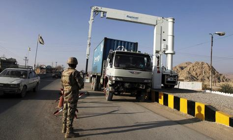 Soldiers scan the contents of a truck at a checkpoint on the main highway outside Quetta